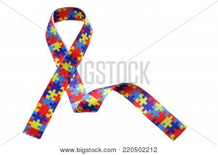 World Autism awareness and pride day with Puzzle pattern ribbon isolated on white background