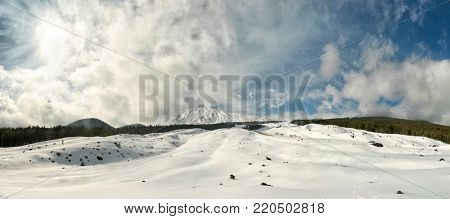 panoramic view of white smoke from snow-covered Etna Volcano, Sicily