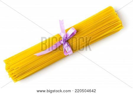 Bunch of spaghetti tied with a ribbon, on a white background. The view from the top.