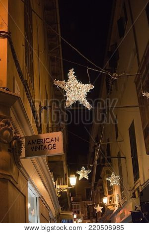 PALMA DE MALLORCA, BALEARIC ISLANDS, SPAIN - DECEMBER 5, 2017: American Vintage store with evening Christmas light decorations on December 5, 2017 in Palma de Mallorca, Balearic islands, Spain.