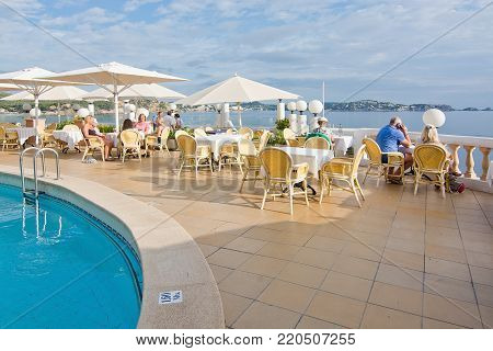 CALA FORNELLS, MALLORCA, BALEARIC ISLANDS, SPAIN - SEPTEMBER 27, 2016: Tortuga restaurant Art Nouveau style Cala Fornells on a sunny day on September 27, 2016 in Cala Fornells, Mallorca, Balearic islands, Spain.