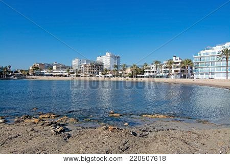 MALLORCA, BALEARIC ISLANDS, SPAIN - NOVEMBER 23, 2017: Tranquil beach Can Pastilla on a sunny day on November 23, 2017 in Mallorca, Balearic islands, Spain.