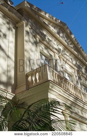 MALAGA, SPAIN - DECEMBER 19, 2017: Detail of sunlit classical style building in Jardin de la Concepcion on December 19, 2017 in Malaga, Spain