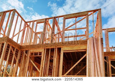 Framed New Construction of a House Building a new house Wooden framing of a home, full frame