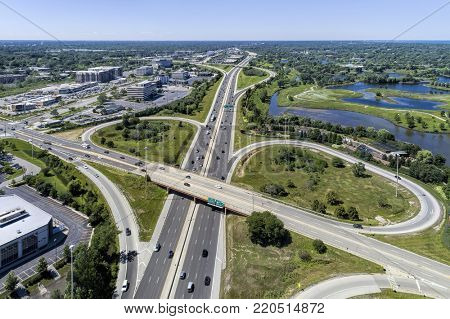 Aerial view of a highways, overpasses, ramps and buildings in the Chicago suburban area of Northbrook, IL. USA