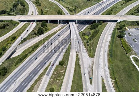 An aerial view of a series of ramps and highway in a suburban setting. Downers Grove, IL. USA