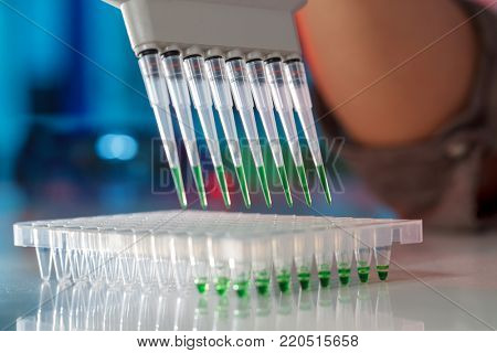 electrophoresis device in a genetics lab to decrypt the genetic code poster