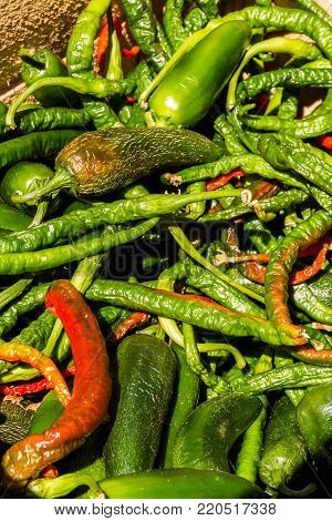 Chilli peppers in a pile making a background.