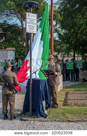 Conegliano, Italy - October 13, 2017: Commemoration ceremony at the monument to the fallen soldiers. Veterans and military are taking part in the event memory. A solemn speech.