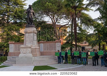 Conegliano, Italy - October 13, 2017: Commemoration ceremony at the monument to the fallen soldiers. Veterans and military are taking part in the event memory. Veterans in the ranks at the monument.