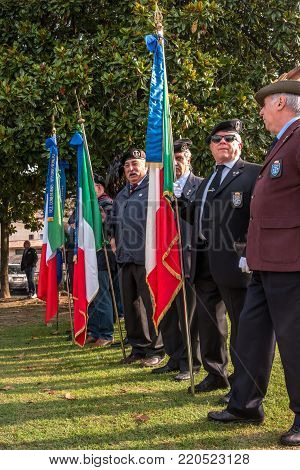Conegliano, Italy - October 13, 2017: Commemoration ceremony at the monument to the fallen soldiers. Veterans and military are taking part in the event memory. Veterans in the ranks.
