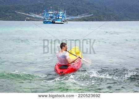 man on canoe concept of travel and recreation