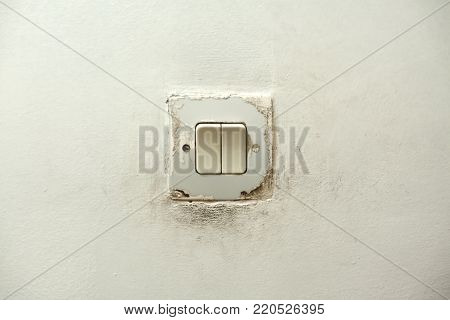 Close up of old Light Switch on wall background. Toggle switch