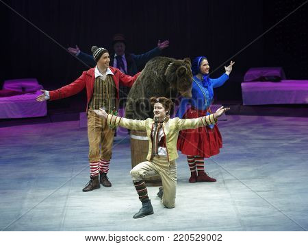 ST. PETERSBURG, RUSSIA - DECEMBER 28, 2017: Actors and trained bears in the show Snow Queen by Great Moscow Circus during tis premiere in St. Petersburg. The show created by Zapashny brothers circus