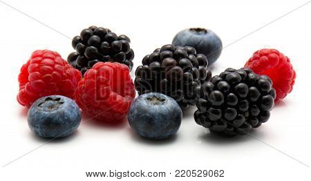 Berries isolated on white background blackberry blueberry and raspberry mix