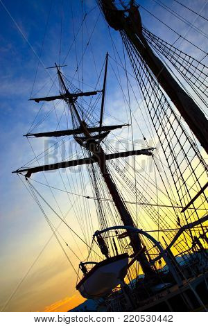 Silhouette of masts of sailing ship