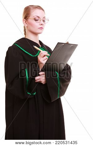 Law court or justice concept. Young woman lawyer attorney wearing classic polish (Poland) black green gown holding writing takes notes on clipboard. Isolated on white background