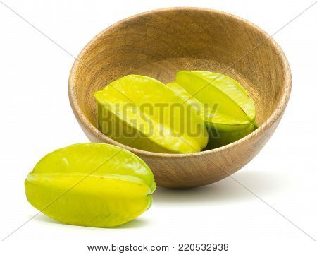 Fresh carambola in a wooden bowl isolated on white background