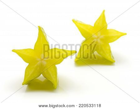 Carambola two halves isolated on white background
