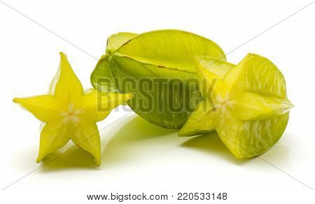 One whole carambola and two halves isolated on white background