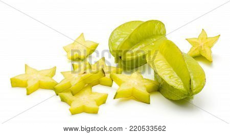 Sliced carambola star slices and two whole isolated on white background