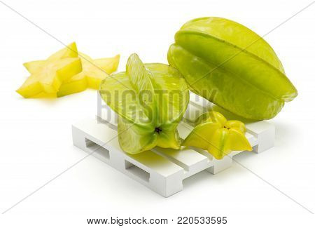 Carambola composition on a pallet isolated on white background