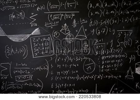 Blackboard with maths statistics, equations and ideas