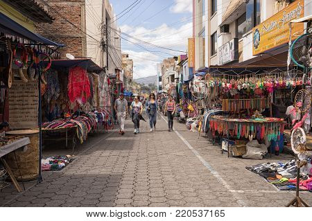 Otavalo, Ecuador-December 23, 2017: vendor stands set up on the street of the indigenous town on the traditional Saturday market day