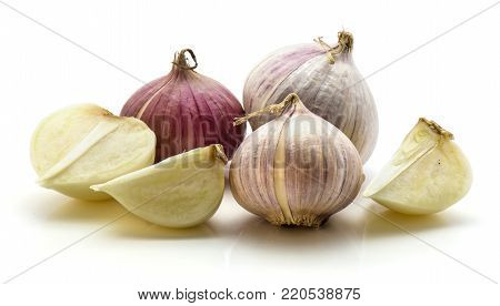 Solo garlic isolated on white background three whole bulbs one half and two quarters