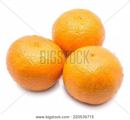 Three whole orange Clementines with water drops isolated on white background