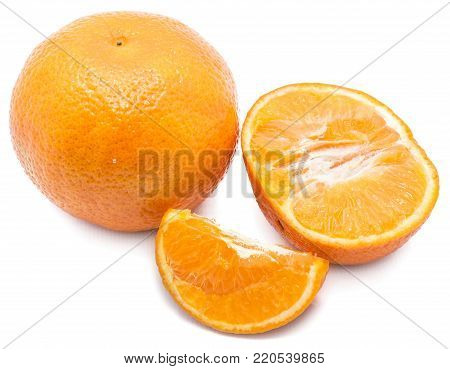 One whole Clementine, one slice and one half isolated on white background
