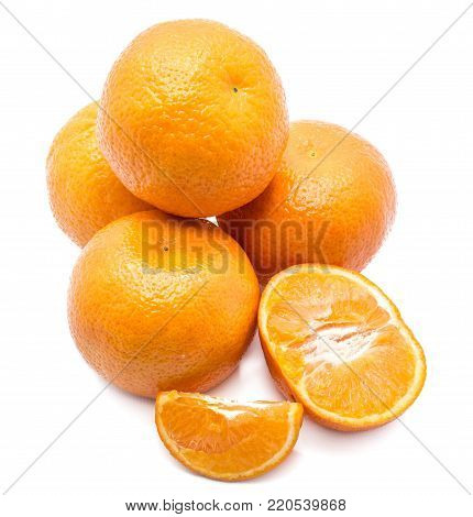Whole Clementines folded in pyramid, one slice and one half isolated on white background