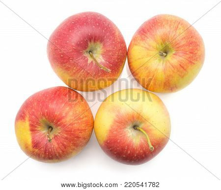 Four apples (Evelina variety) isolated on white background top view