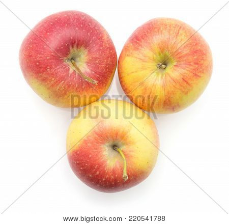 Three apples (Evelina variety) isolated on white background top view