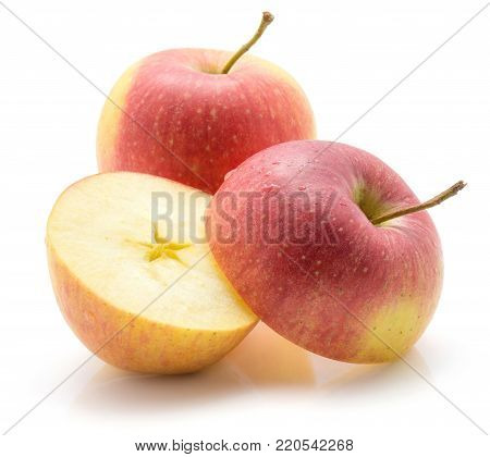 Apples (Evelina variety) isolated on white background one whole and one sliced