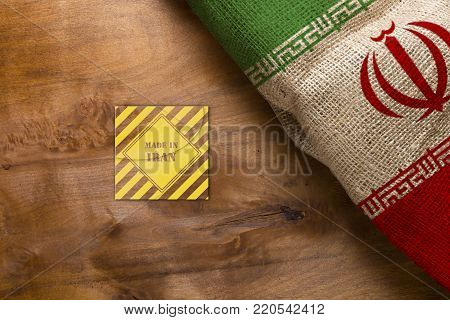 The national flag of Iran and symbol made in Iran.