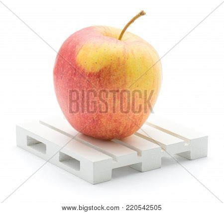 One apple (Evelina variety) on a pallet isolated on white background red yellow