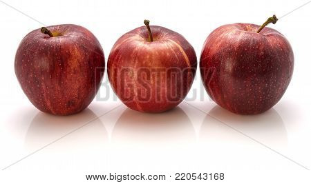 Three whole Gala apples in row isolated on white background