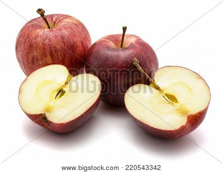 Gala apples, two whole and one cut in half, isolated on white background