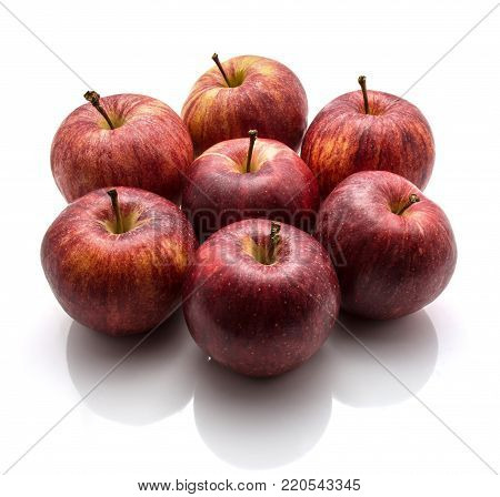 Whole Gala apples folded in a flower isolated on white background