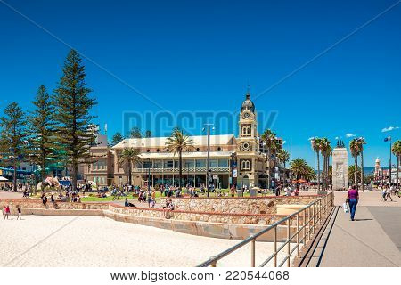 Glenelg, South Australia - February 28, 2016: People relaxing at Moseley Square in Glenelg on a bright summer day viewed from jetty