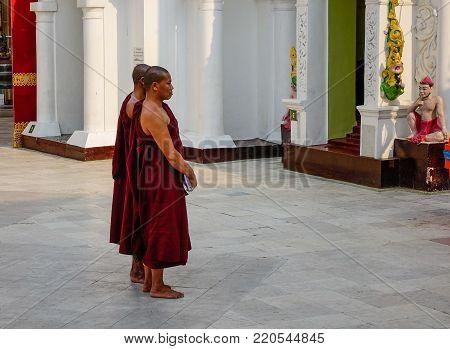 Prayers At Shwedagon Pagoda In Yangon