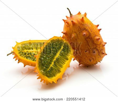 Kiwano isolated on white background one whole orange color two sliced halves with green flesh