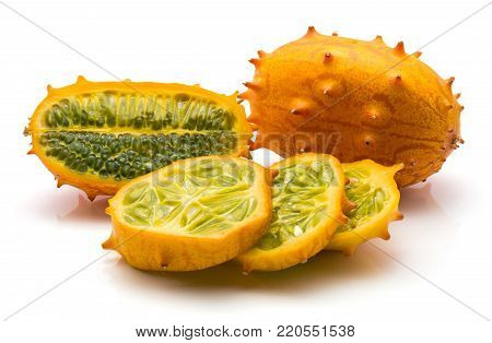 Sliced kiwano isolated on white background one whole one cross section and three slices