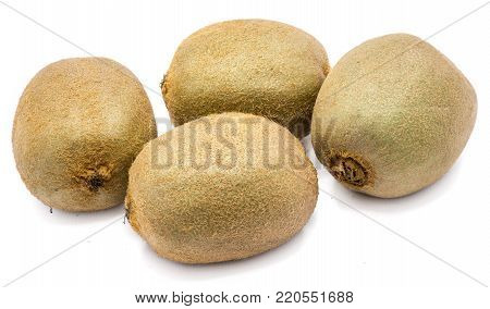 Group of four whole fuzzy kiwi fruits (Chinese gooseberry) isolated on white background