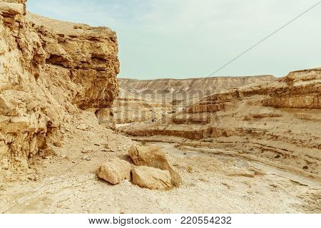 View on desert mountains, rocks and sky near the dead sea in Israel. Infinity valley panorama of lone sand, hills and stones. Waterless middle east territory, silence and heat.