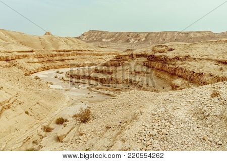 View on judean desert mountain, rock and blue sky near the dead sea in Israel. Infinity valley panorama of lone sand, hills and stones. Waterless middle east territory, silence and heat.