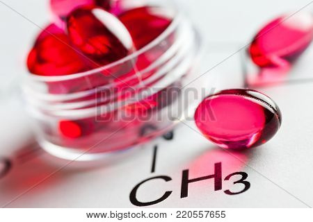 Painkiller tablets - pink caps with molecules chemical formulas - health care and medicine concept