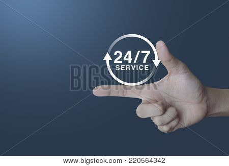 24 hours service icon on finger over light gradient blue background, Full time service concept