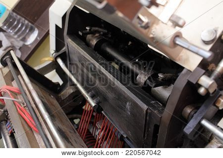 Industrial machine in the printing manufacture. Macro photo